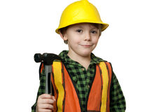 Little construction worker. Young boy construction worker in a hard hat , on a white background Royalty Free Stock Photo