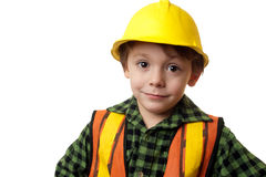 Little construction worker. Young boy construction worker in a hard hat , on a white background Royalty Free Stock Images