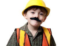 Little construction worker. Young boy construction worker in a hard hat , on a white background Stock Photography