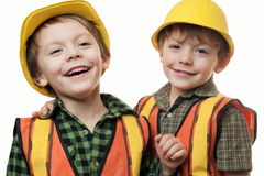 Little construction worker. Young boy construction worker in a hard hat , on a white background Stock Photos