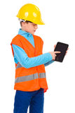 Little construction worker with a digital tablet Royalty Free Stock Images