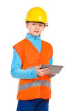 Little construction worker holding a digital tablet Royalty Free Stock Image