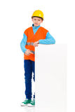 Little construction worker pointing at a banner stock images