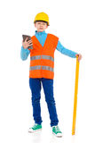 Little construction worker posing with a spirit level Stock Photo