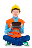 Little construction worker showing a digital tablet Stock Photos
