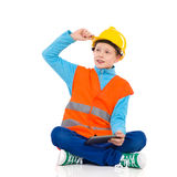 Little construction worker sitting with a digital tablet Stock Images