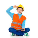 Little construction worker sitting with a digital tablet Stock Photo