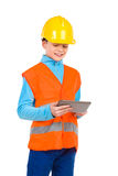 Little construction worker using a digital tablet Stock Photography