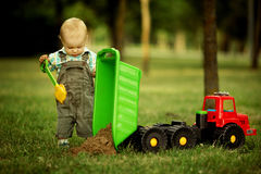 Little constructor with shovel Stock Images