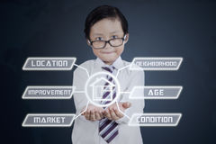 Little consultant shows property value Royalty Free Stock Photography
