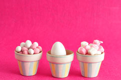 Little containers filled with candy and an easter egg Stock Images