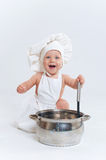Little cook. Cute little boy in a suit of Food Boy with kitchen accessories. In the studio Stock Images