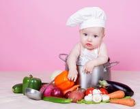 Little cook. Little baby cook in studio Stock Photo