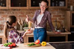 Girl prepare salad healthy food family cooking royalty free stock image