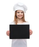 Little cook or baker with blank black paper Royalty Free Stock Images