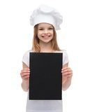 Little cook or baker with blank black paper Stock Image