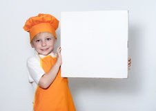 Little cook with a box for pizza. Portrait of the little cook with a box for pizza Stock Photo