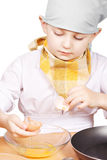 Little cook breaking egg Royalty Free Stock Image