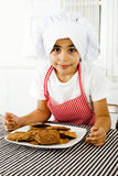 Little cook and cookies Royalty Free Stock Photography