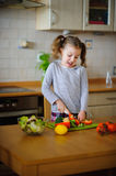Little cook cooks salad. On a table various vegetables. Stock Images