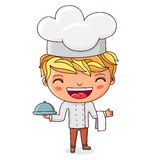 Little cook with dish in hand Royalty Free Stock Photo