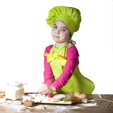 Little cook. Little girl helps cook bake cookies for the holiday Stock Photo