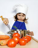 Little Cook Girl Preparing Food Royalty Free Stock Photos