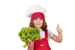 Little cook with green salad and thumb up Royalty Free Stock Image