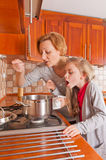Little cook and her mom Stock Photos
