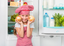 Little cook holding onions Royalty Free Stock Image