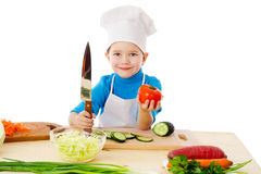 Little cook with knife and tomatoes Stock Photos
