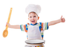 Little cook with ladle and pan Royalty Free Stock Photography