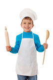 Little cook with ladle and rolling pin Stock Image
