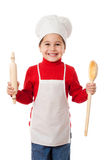 Little cook with ladle and rolling pin Royalty Free Stock Photos