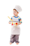 Little cook standing with ladle and pan Royalty Free Stock Image