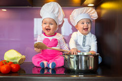 Little cook twins. Royalty Free Stock Image
