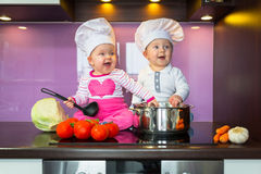 Little cook twins. Royalty Free Stock Images