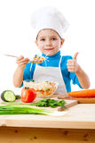 Little cooker with salad and thumb up sign. Isolated on white Royalty Free Stock Photo