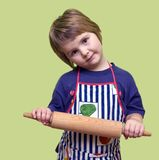 A little cooky in striped apron Stock Images
