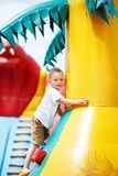 Little cool boy have fun on an inflatable trampoline Stock Photos