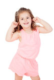 Little cool girl covering her ears with the fingers Royalty Free Stock Photo