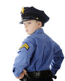 Little Cop Looking Over Shoulder Royalty Free Stock Image