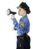 Little Cop Using Megaphone. An adorable young policeman calling through a megaphone.  Isolated on white Stock Photo