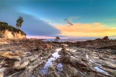 Little Corona Beach in Corona Del Mar. California at sunset in summer Royalty Free Stock Photos