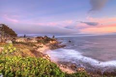 Little Corona Beach in Corona Del Mar. California at sunset in summer Royalty Free Stock Image