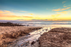 Little Corona Beach in Corona Del Mar. California at sunset in summer Royalty Free Stock Photography