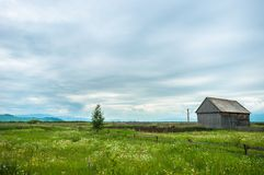 Little cottage with blue sky Stock Photography