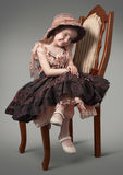 Little Countess. Little girl sitting on a chair a luxurious Royalty Free Stock Images