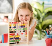 Little counting on the colourful abacus in the school classroom Royalty Free Stock Image