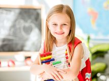 Little counting on the colourful abacus in the school classroom Royalty Free Stock Images